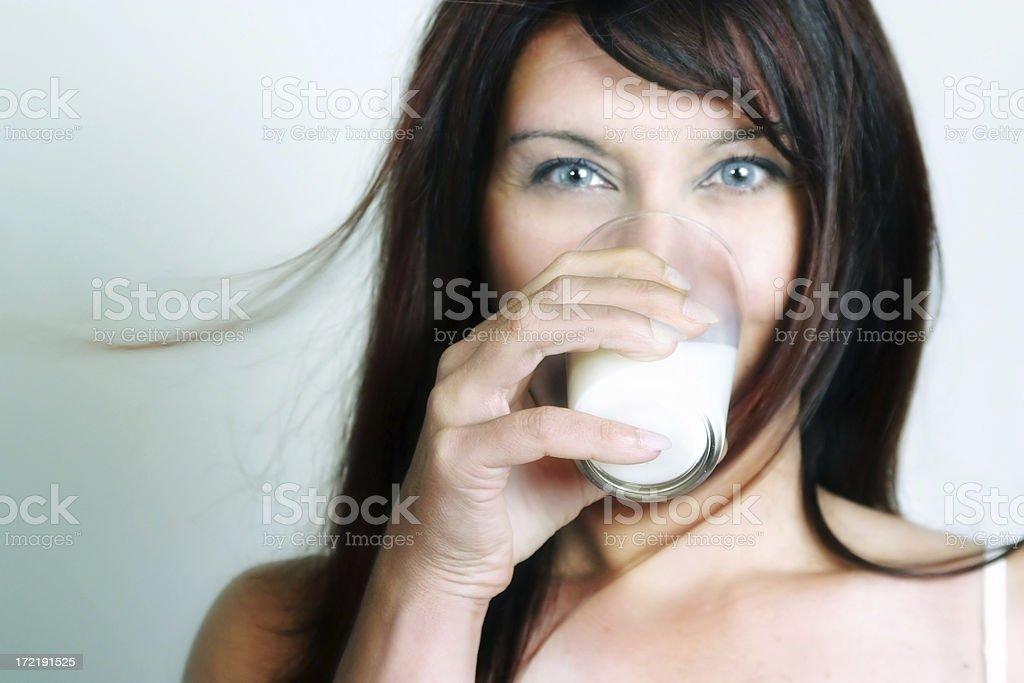 Woman drinking milk royalty-free stock photo