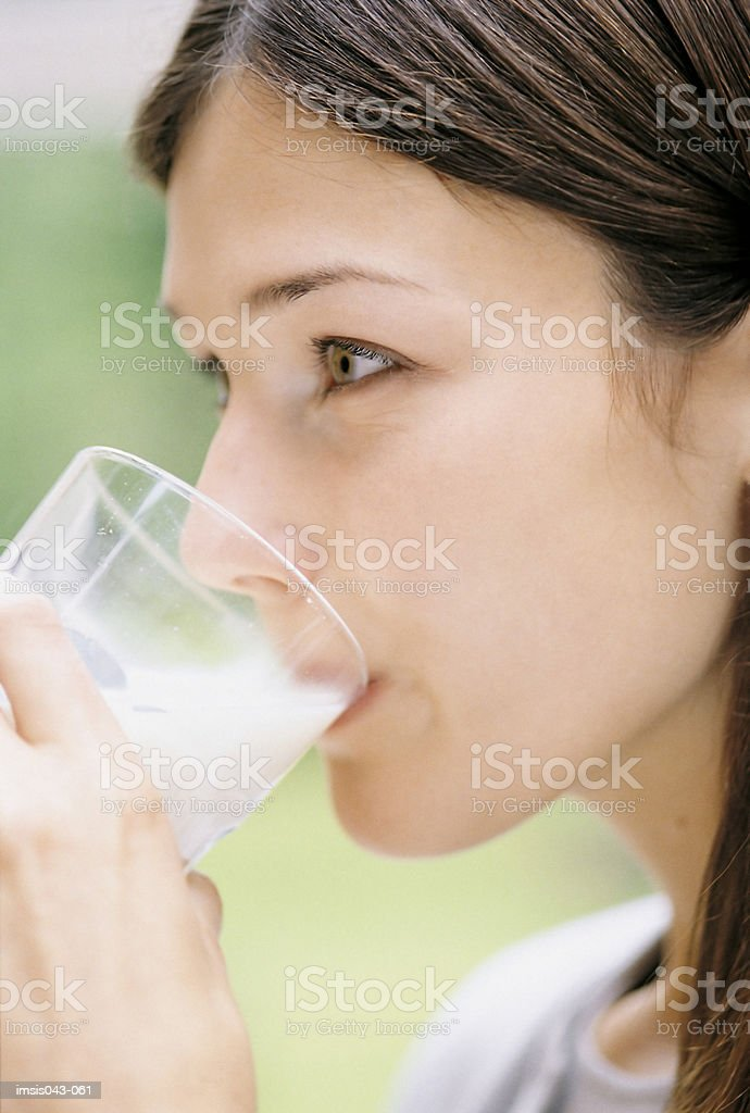 Woman drinking milk royalty free stockfoto