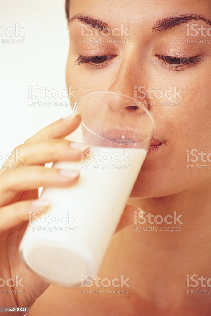 Woman drinking milk royalty-free stock photo
