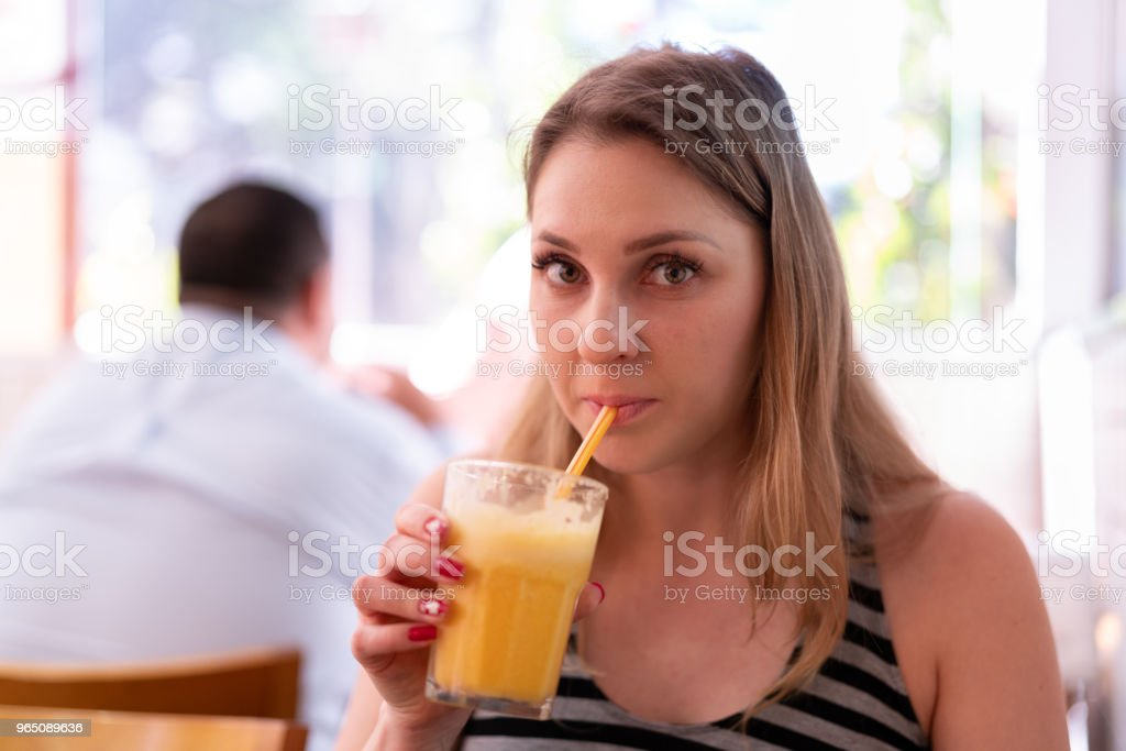 Woman drinking orange juice royalty-free stock photo