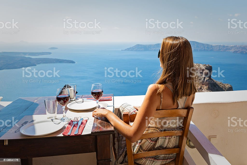 Woman drinking red wine stock photo