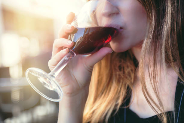 Woman drinking rose wine stock photo