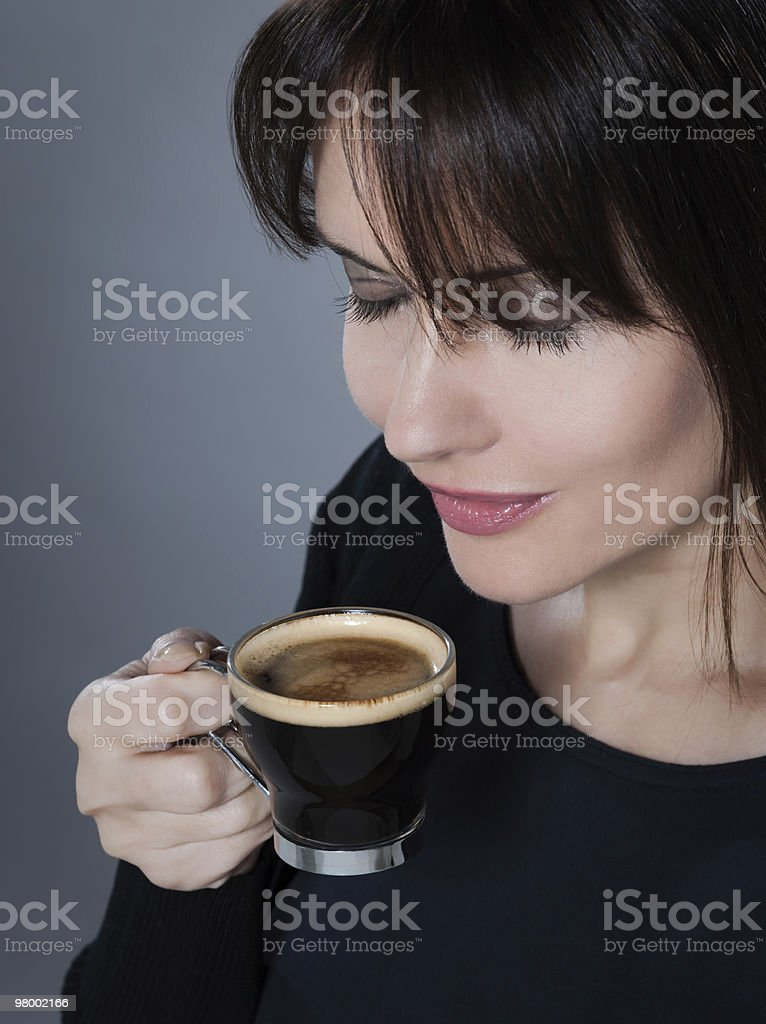 woman drinking smelling coffee expresso royalty-free stock photo