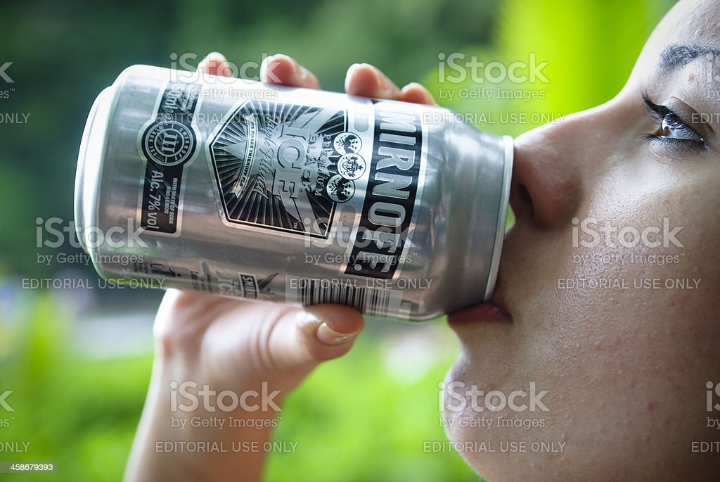 Woman drinking Smirnoff Ice stock photo