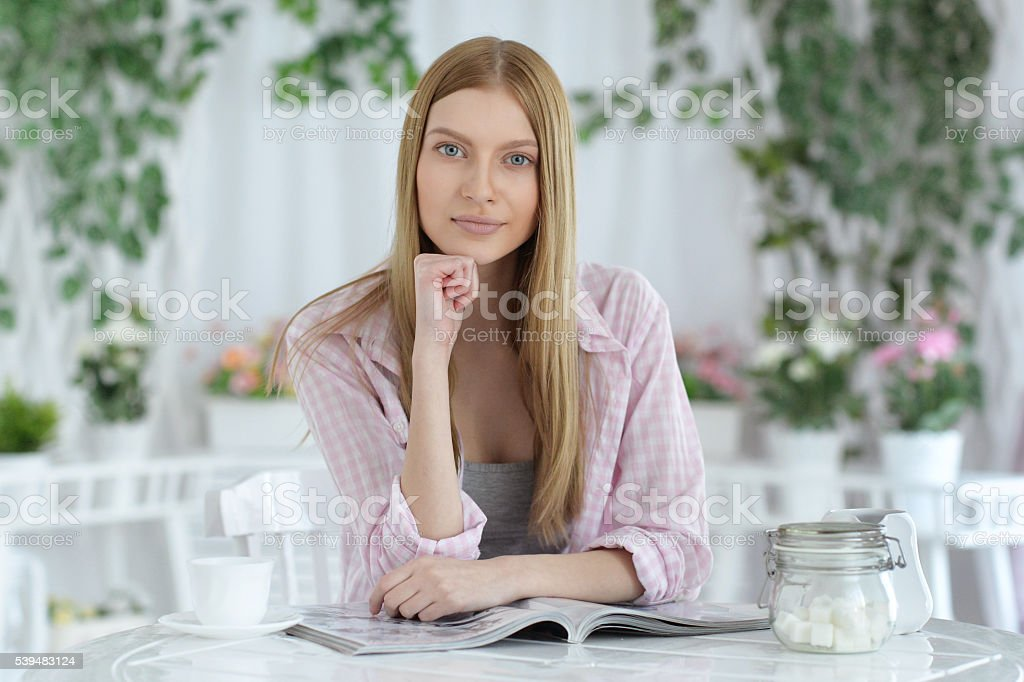 woman  drinking tea at cafe stock photo