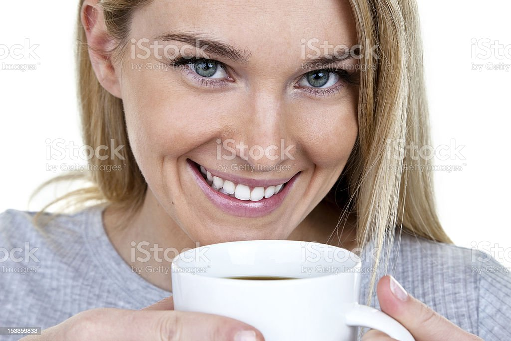 Woman drinking tea or coffee royalty-free stock photo