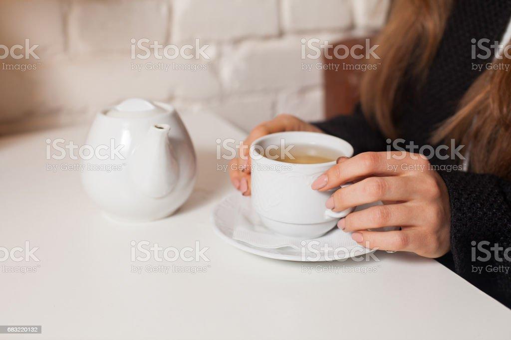 Woman drinking tea foto de stock royalty-free