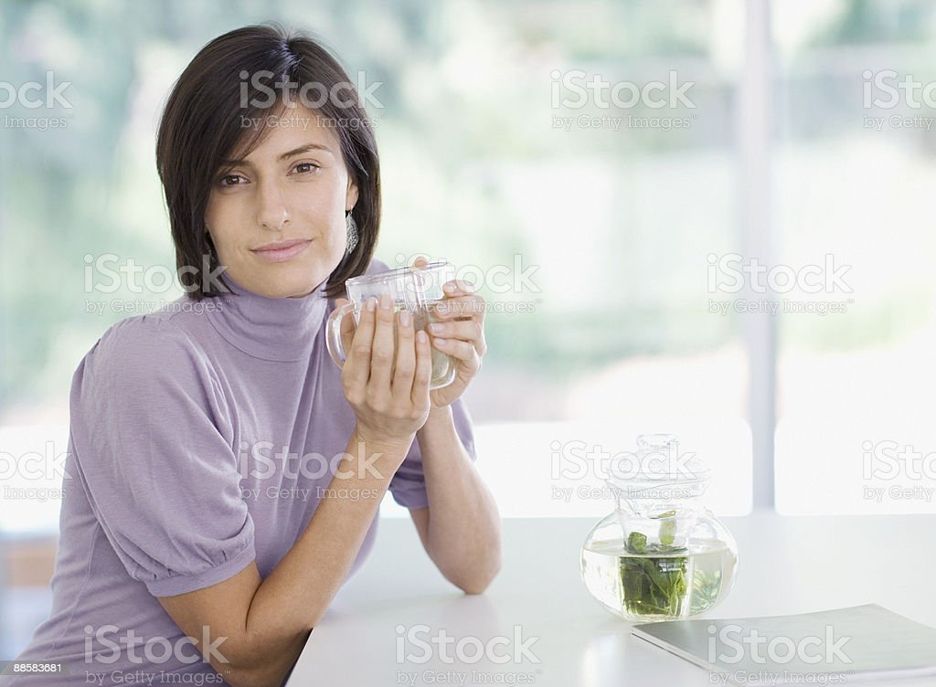 Woman drinking tea royalty-free stock photo