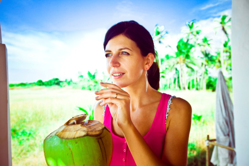 Woman Drinking Tropical Cocktail Stock Photo - Download Image Now