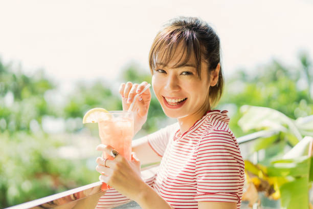woman drinking tropical juice - guam foto e immagini stock