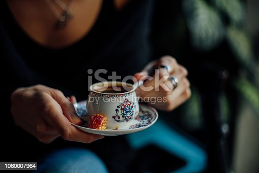 Woman drinking turkish coffee