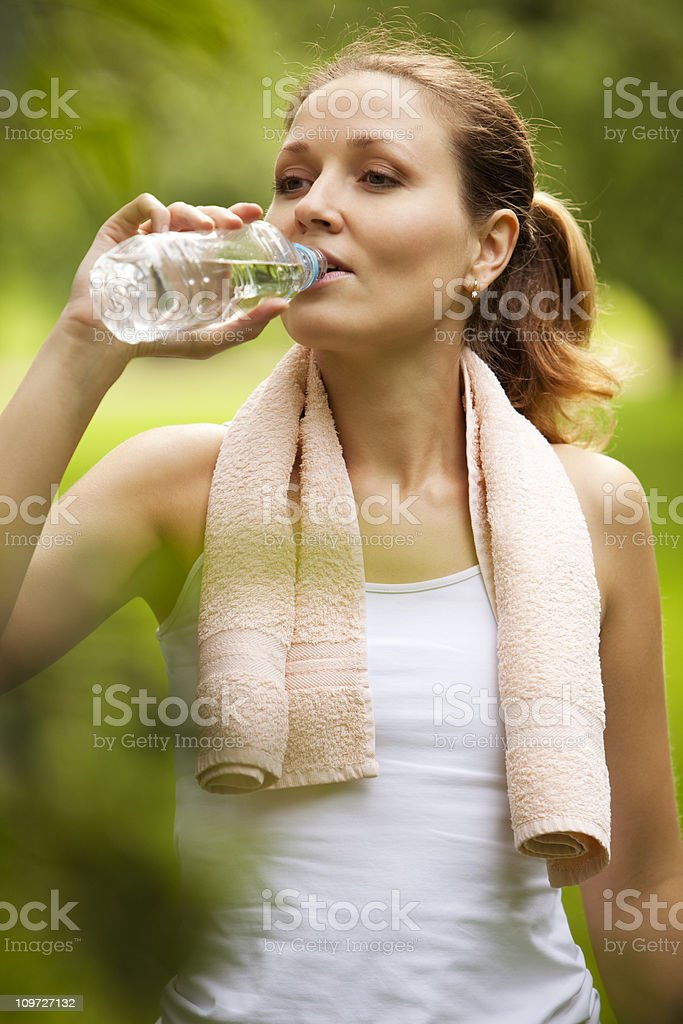 Woman drinking water after sport activities royalty-free stock photo