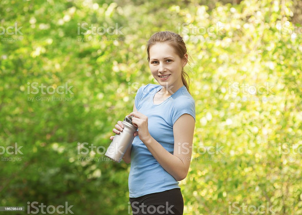 Woman drinking water after workout royalty-free stock photo