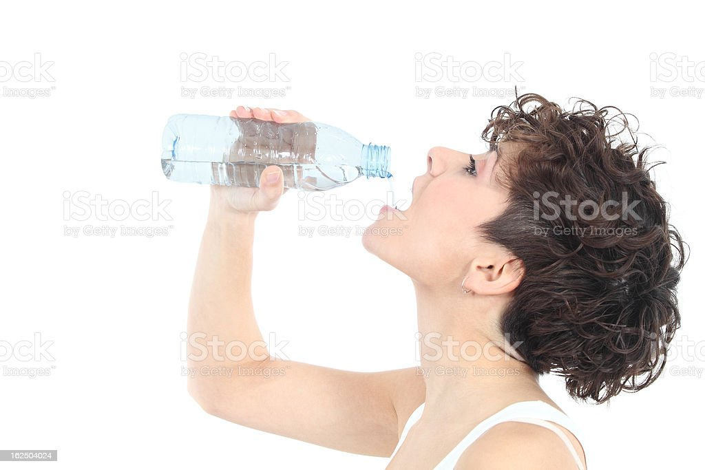 Woman drinking water from a plastic bottle royalty-free stock photo