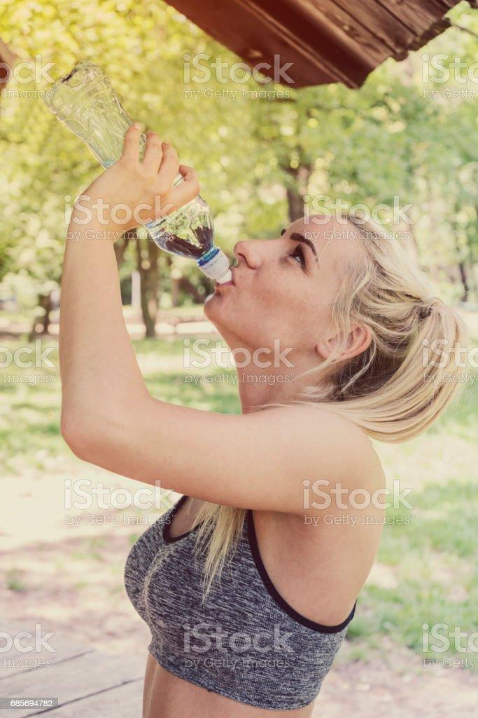 Woman drinking water 免版稅 stock photo