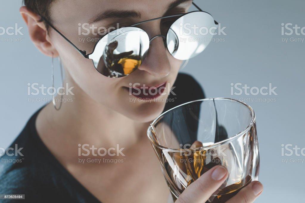 woman drinking whiskey stock photo