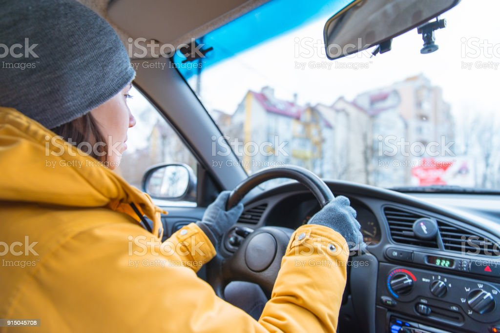 woman drive car in cold winter weather stock photo