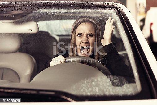 1138361116 istock photo Woman driver frustrated by traffic on wet winter day 517075929