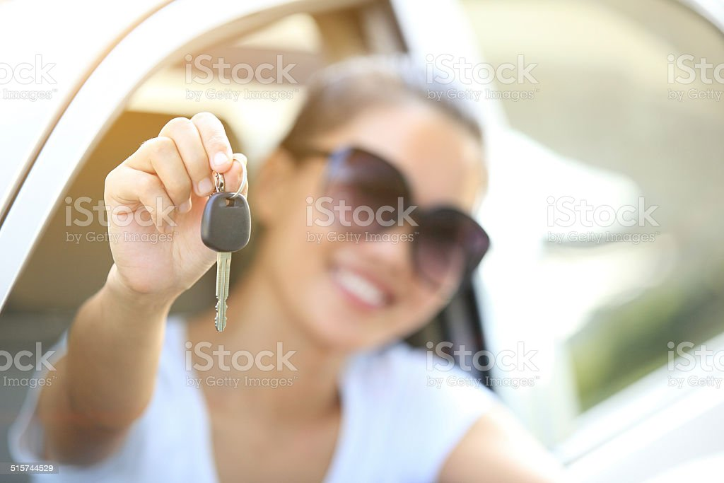 woman driver happy sit with car keys in hands stock photo