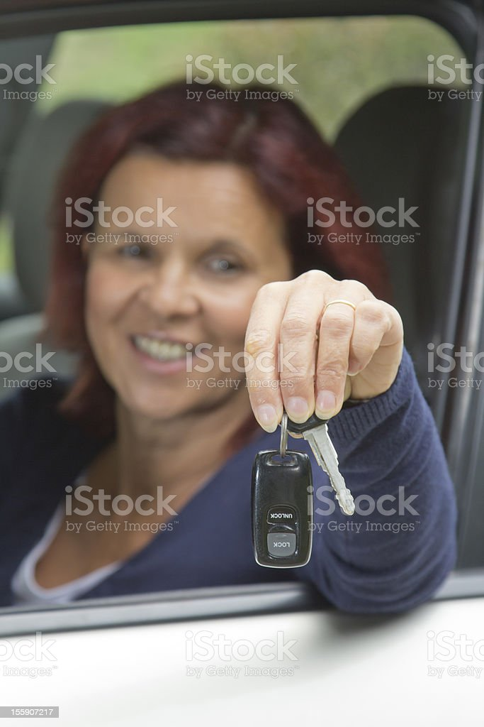 Woman driver holding car keys royalty-free stock photo