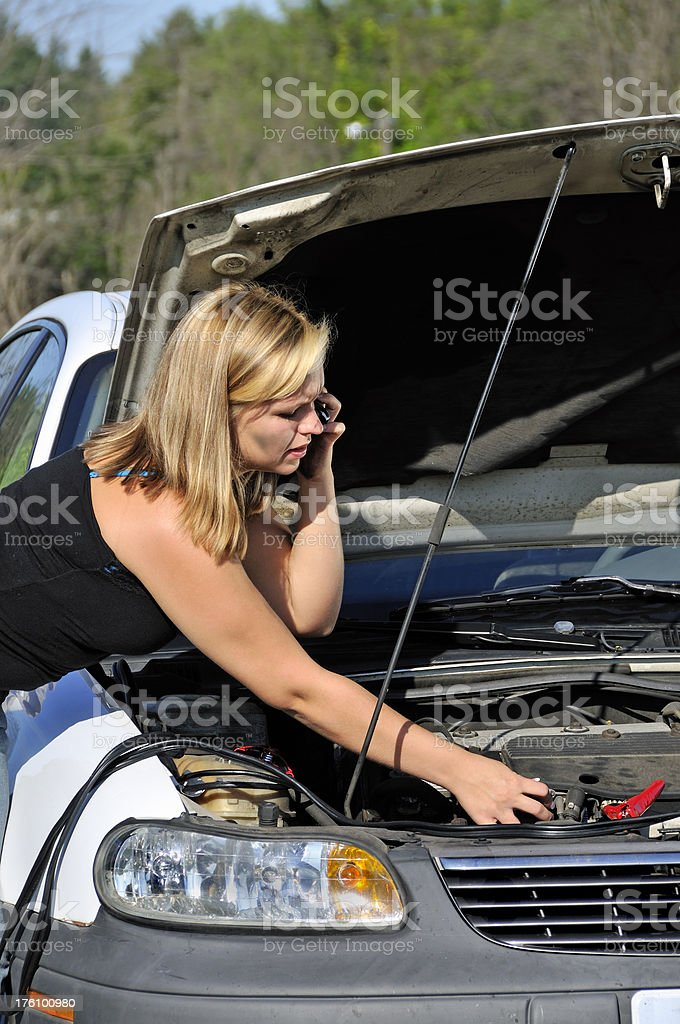 Woman Driver on Phone with Mechanic royalty-free stock photo