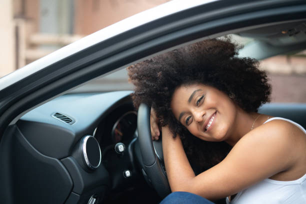Woman Driver Portrait at Car Interior - Pride stock photo