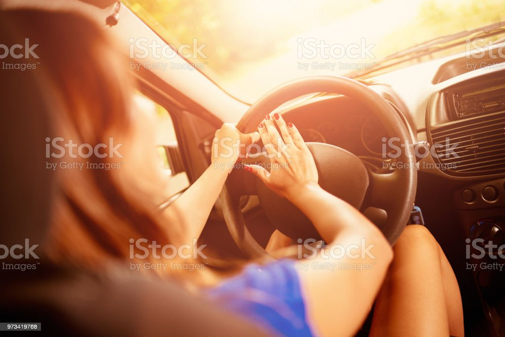 Woman Driver Pressing In A Horn stock photo