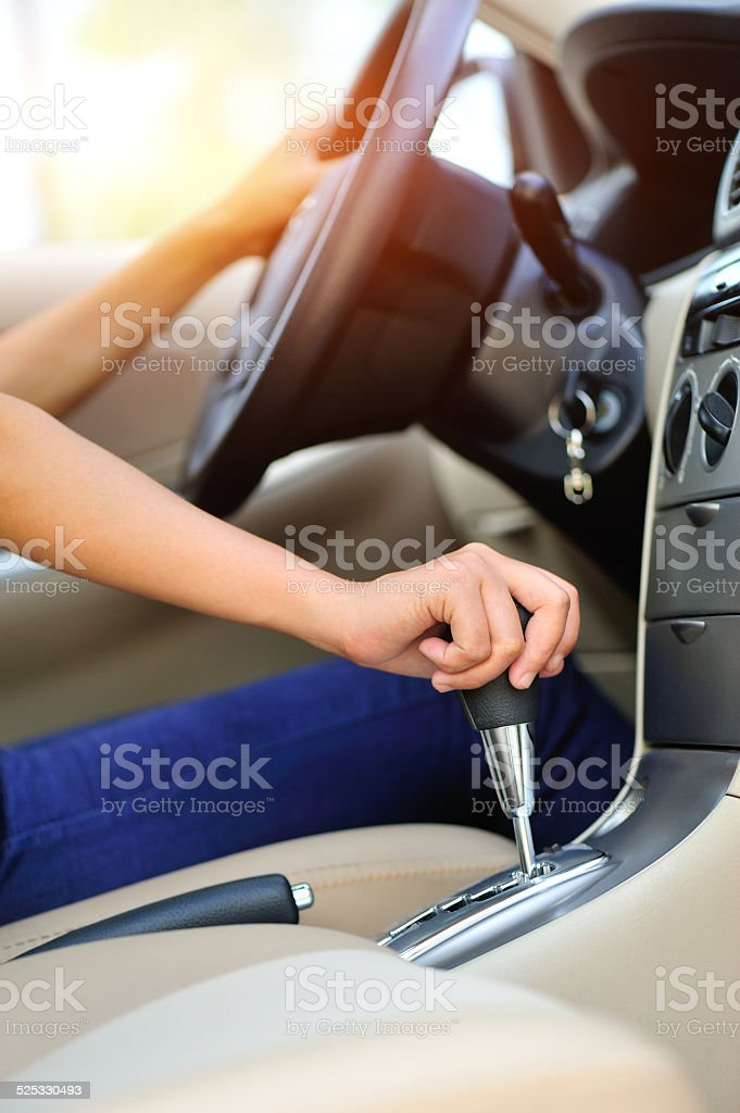 woman driver shifting the gear stick stock photo