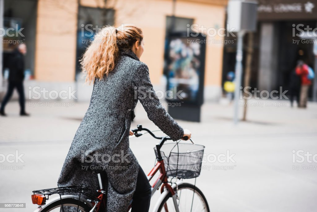 Woman driving a bike in the city stock photo