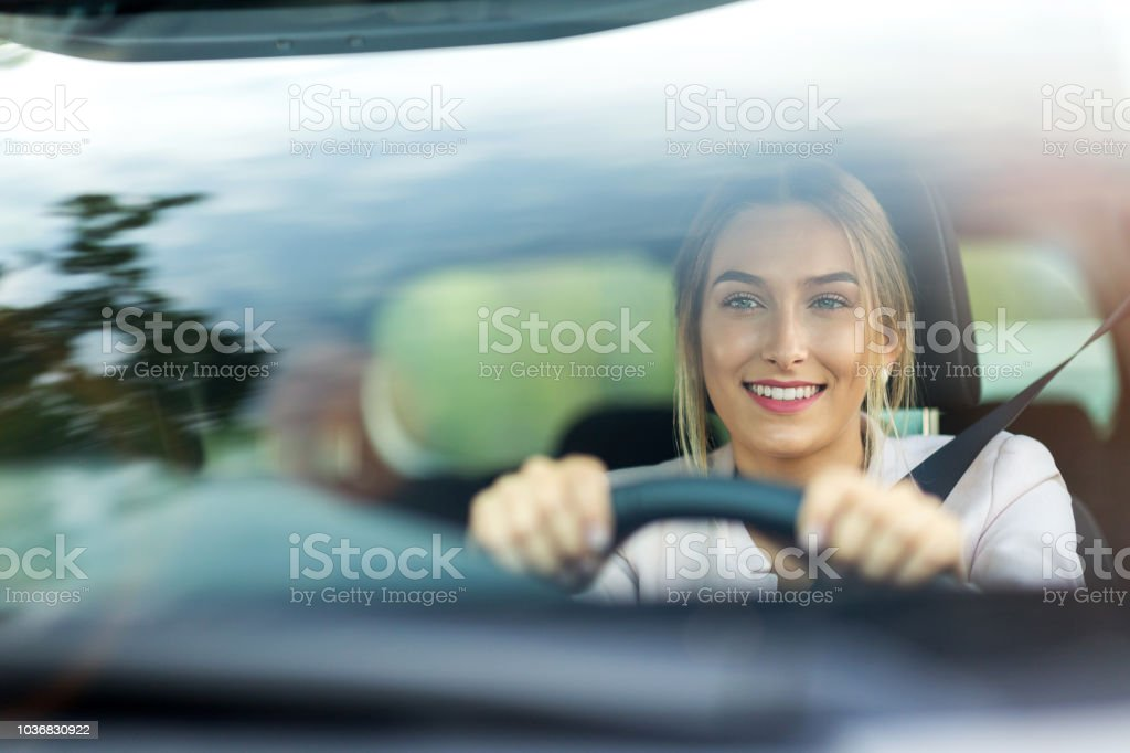Woman driving a car Young woman sitting in a car Adult Stock Photo