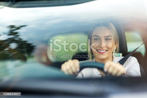 istock Woman driving a car 1036830922