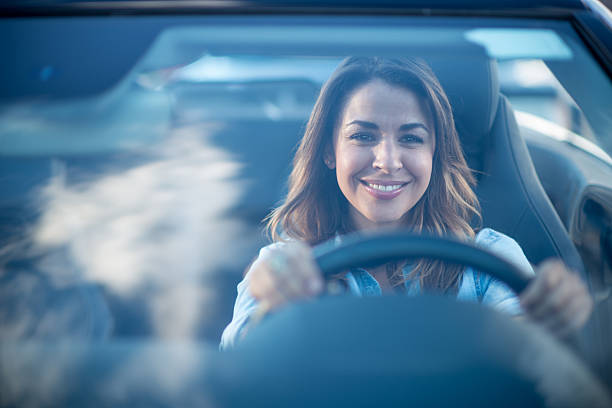 woman driving a car - driver stock photos and pictures