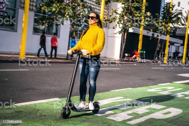 Woman driving an electric scooter on a scooter bike lane in the city picture id1125854934?b=1&k=6&m=1125854934&s=612x612&h=ml1rz73xntk2o2fkggnytlum2qispcsdr4fec50t6zg=