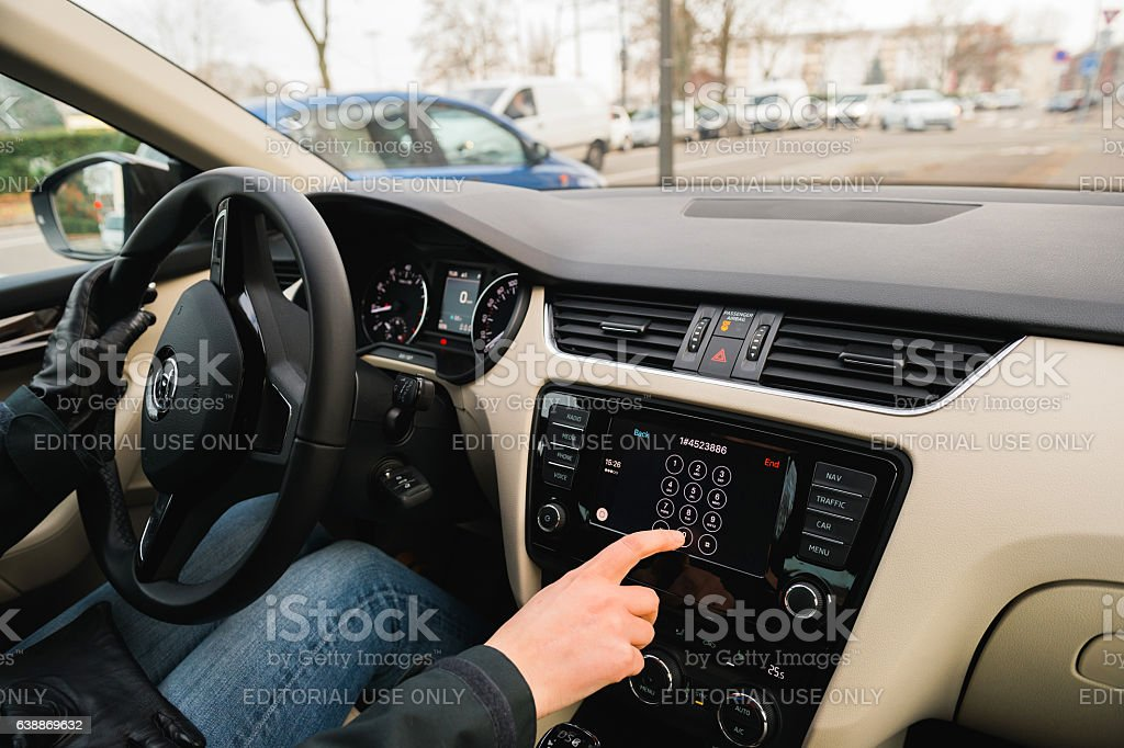 Woman driving calling voicemail from Car Play Apple Car dashboar stock photo