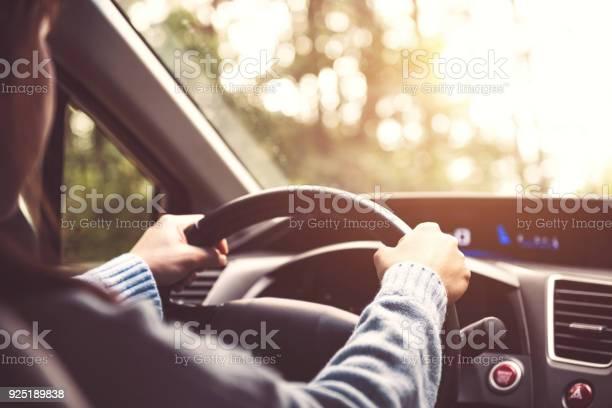 Woman driving car at sunny picture id925189838?b=1&k=6&m=925189838&s=612x612&h=xt5wsqxspx7y6ufouueyispr56gukxfbgh2u1kpdza4=
