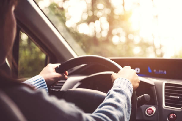 woman driving car at sunny. - driver stock photos and pictures