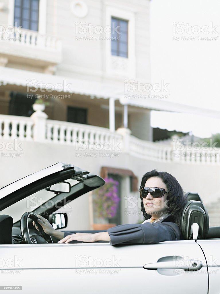 Woman driving convertible royaltyfri bildbanksbilder