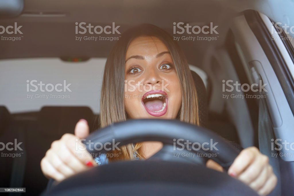 Fright face of woman, driving car. Closeup portrait displeased angry...