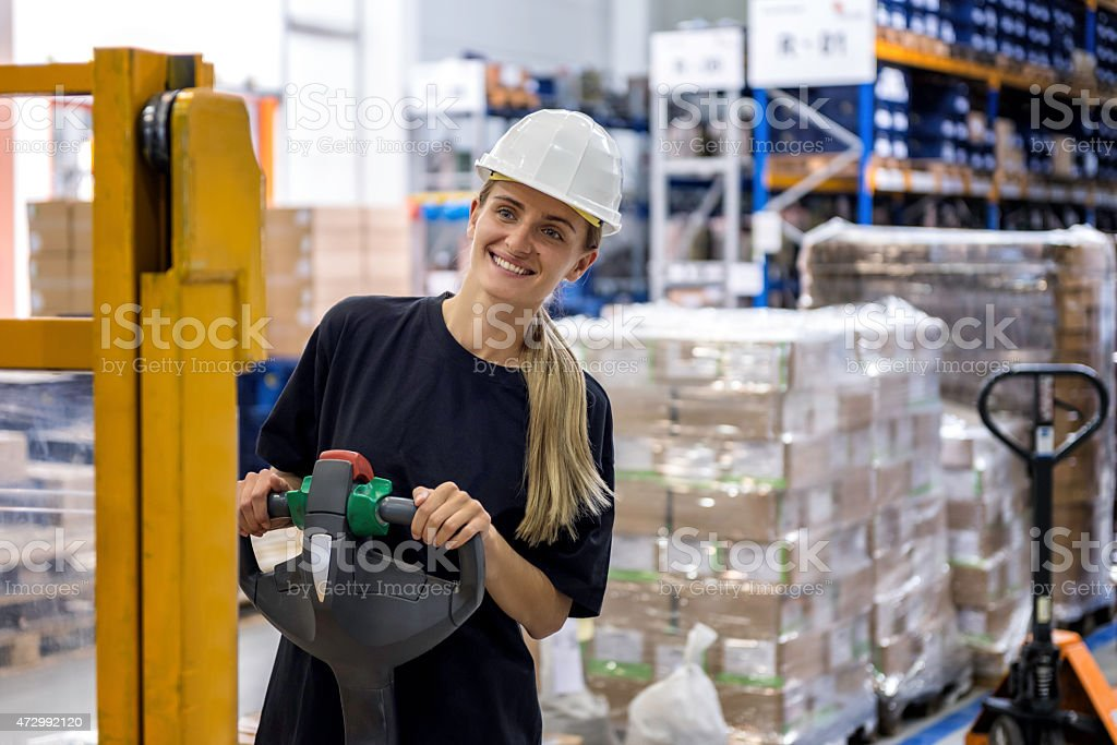 Woman driving pallet truck stock photo