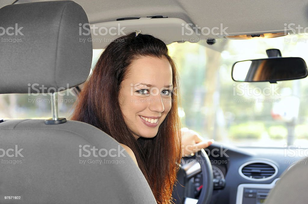 Woman driving reverse royalty-free stock photo