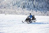 Woman driving snowmobile
