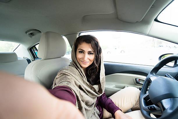 woman driving the car in abu dhabi stock photo