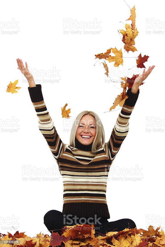 woman drop autumn leaves in studio royalty-free stock photo