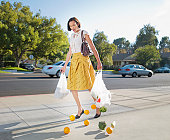 istock Woman dropping groceries on sidewalk 90201027