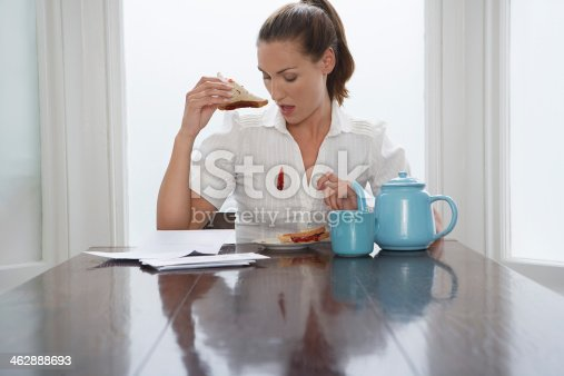istock Woman dropping jam down her blouse at breakfast 462888693