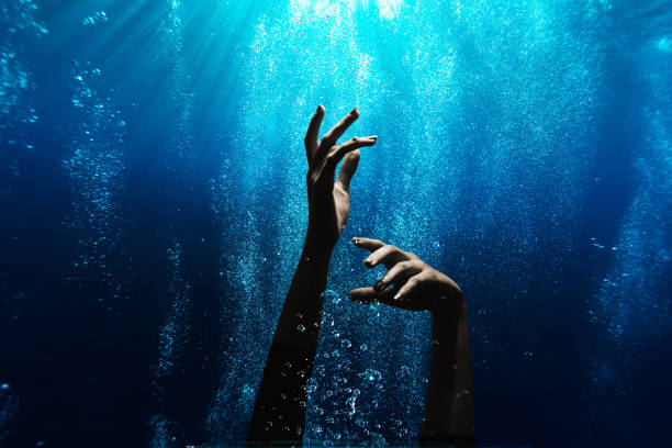 Woman drowning underwater stock photo