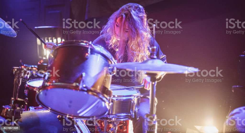 Woman drummer stock photo