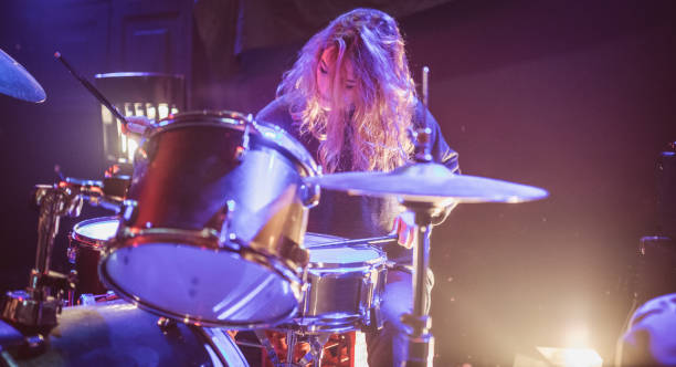 Woman drummer Woman drummer playing drums on stage in the club drummer stock pictures, royalty-free photos & images