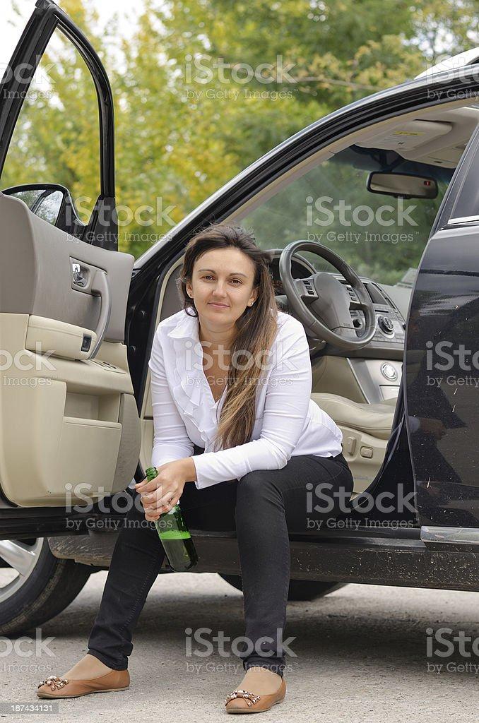 Woman drunkard in a car stock photo