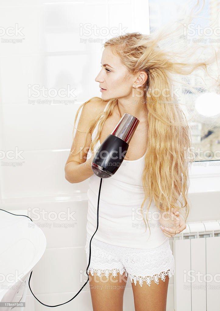 Woman dry hair royalty-free stock photo